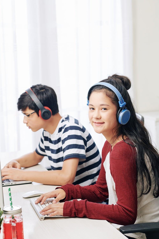 Teenagers working on computers