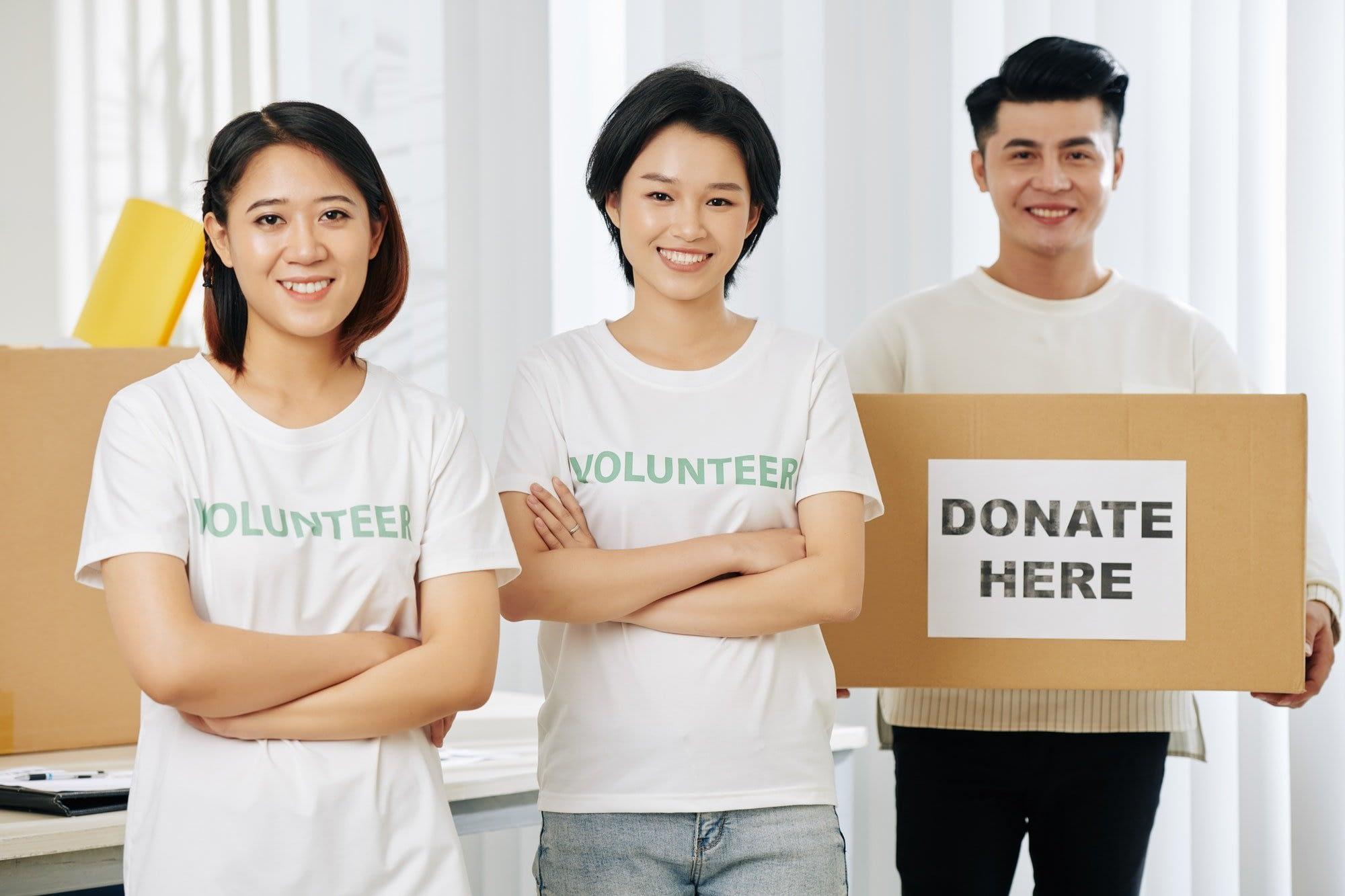 Young happy volunteers