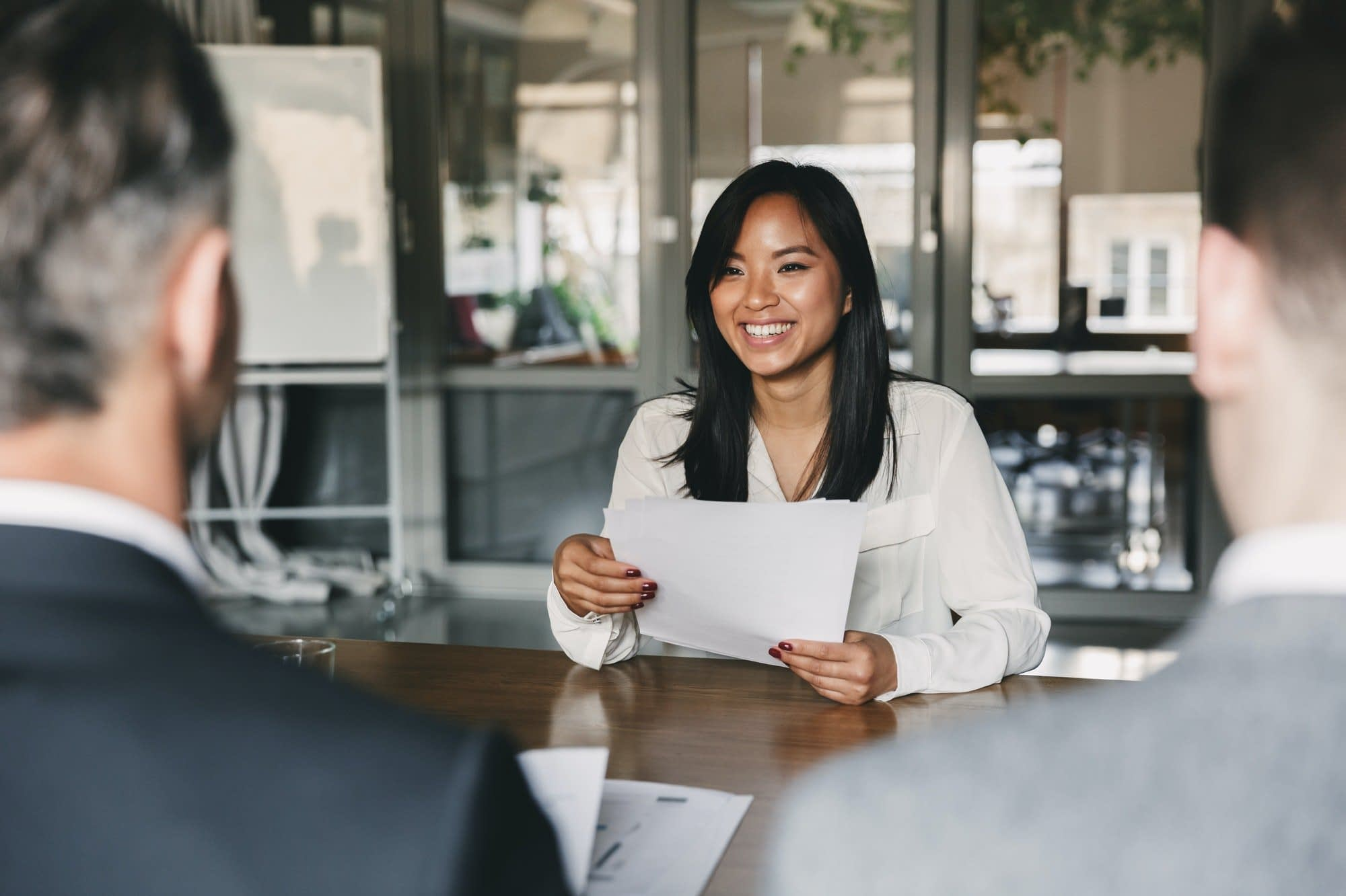 Business, career and placement concept - young asian woman smili