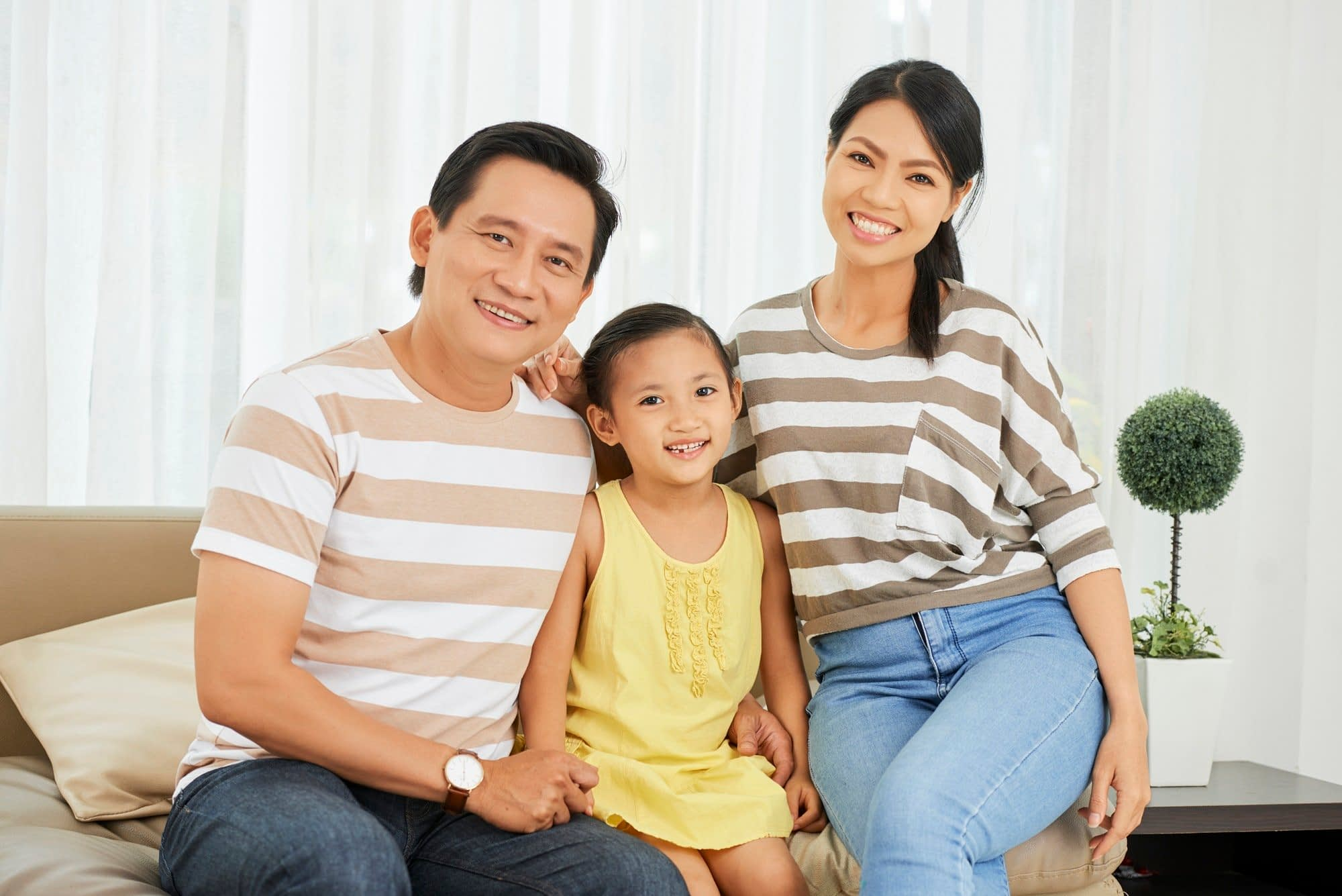 Asian family sitting at home