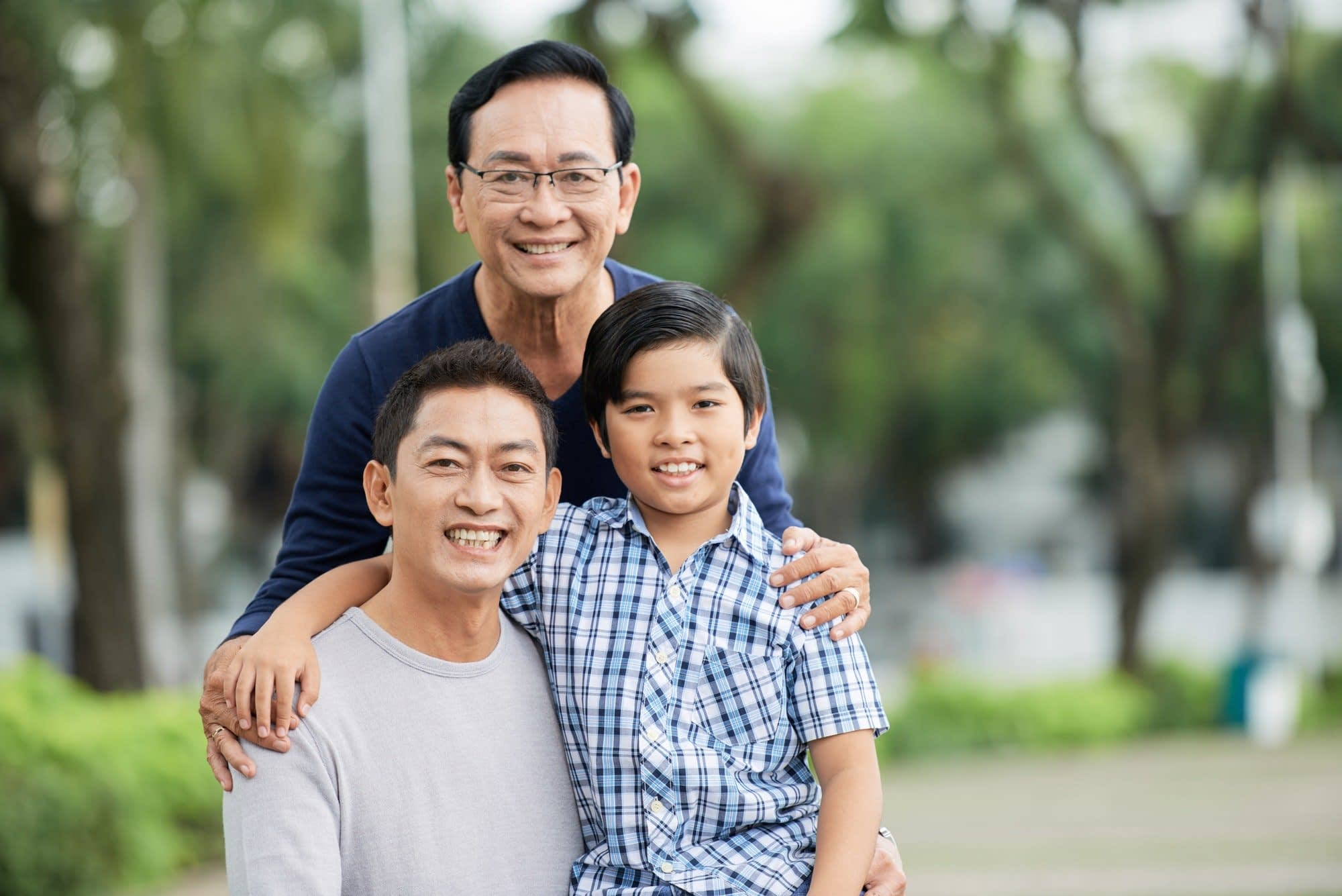 Elderly Asian man with son and grandson