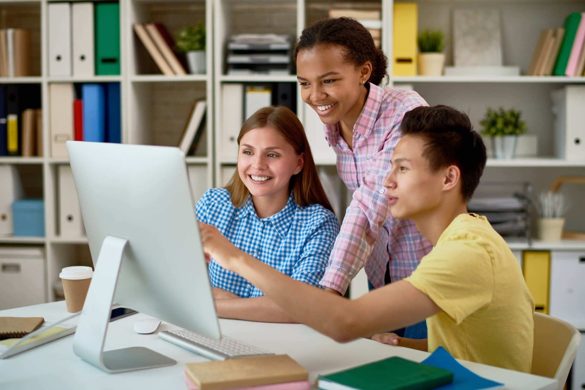 Smiling Students Working with Computer